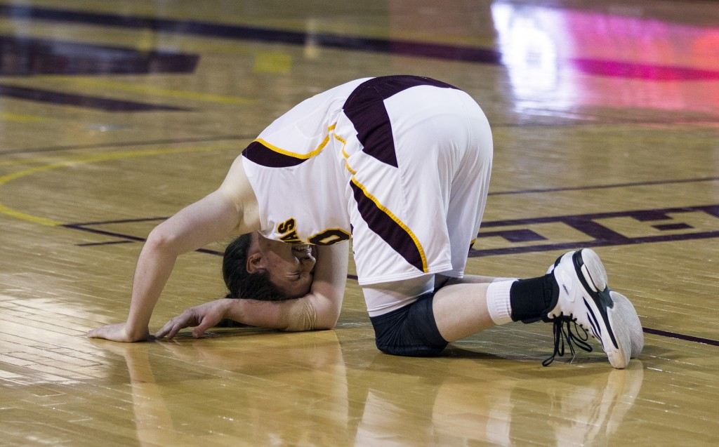 Central Michigan's Cassandra Breen writhes in pain on the court during their game against Eastern Michigan. (Photo I Rich Drummond)