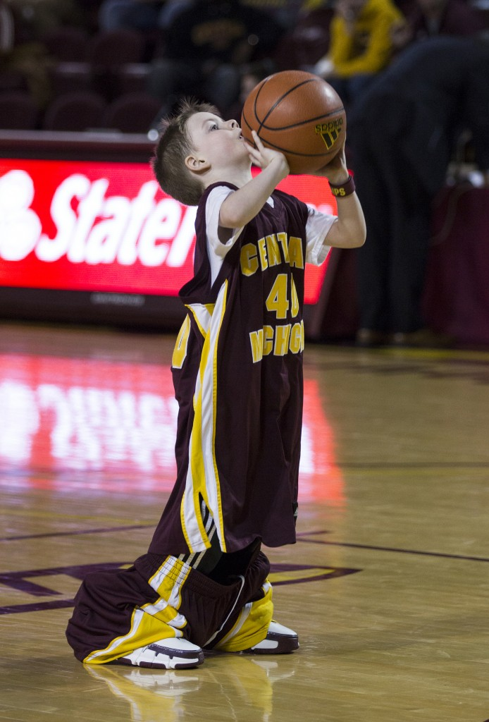 A young Central Michigan fan competes in a contest, during half time at McGuirk Arena. (Photo I Rich Drummond)