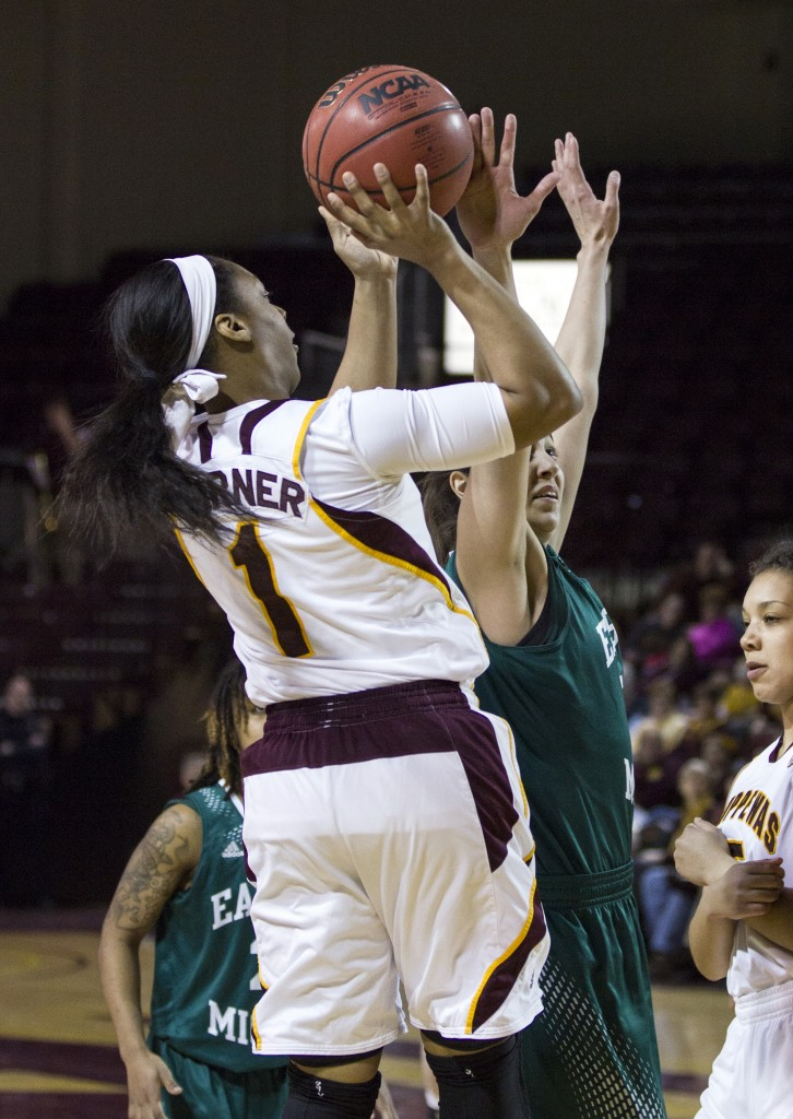 Central Michigan's Da'Jourie Turner's, (1), shot is contested by Eastern Michigan's Sera Ozelci, right. (Photo I Rich Drummond)