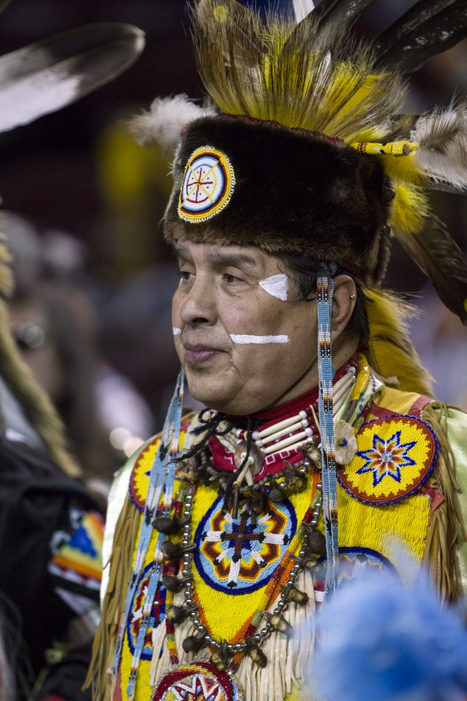 Ray Cadotte stares into the crowd during the Anishinaabe Pow wow in McGuirk Arena. (Photo I Rich Drummond)