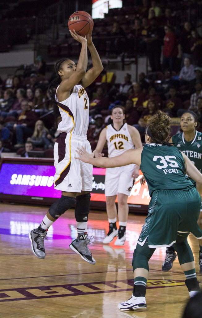 Central Michigan's Lorreal Jones, (2),throws up a shot against Eastern Michigan's Brianna Puni, (35). (Photo I Rich Drummond)