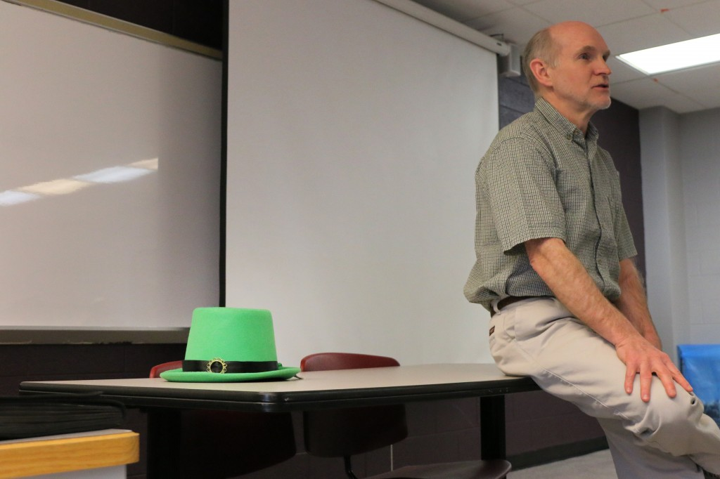 A green hat sits at the front of CMU journalism professor Tim Boudreau's class on March 17, 2015. (Photo I Kaiti Chritz)
