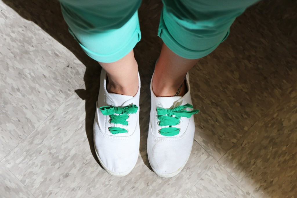 Sammy Madar wears green pants and white shoes with laces for St. Patty's day in March 17, 2015. (Photo I Kaiti Chritz)
