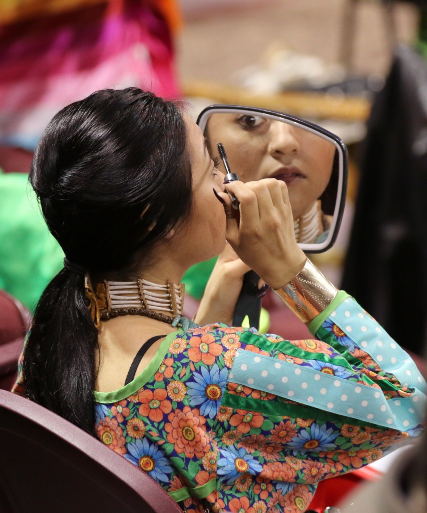 Tess Knight applies makeup in preparation for the dancing competition at the 26th Annual Celebrating Life Pow wow. (Photo I Kaiti Chritz)