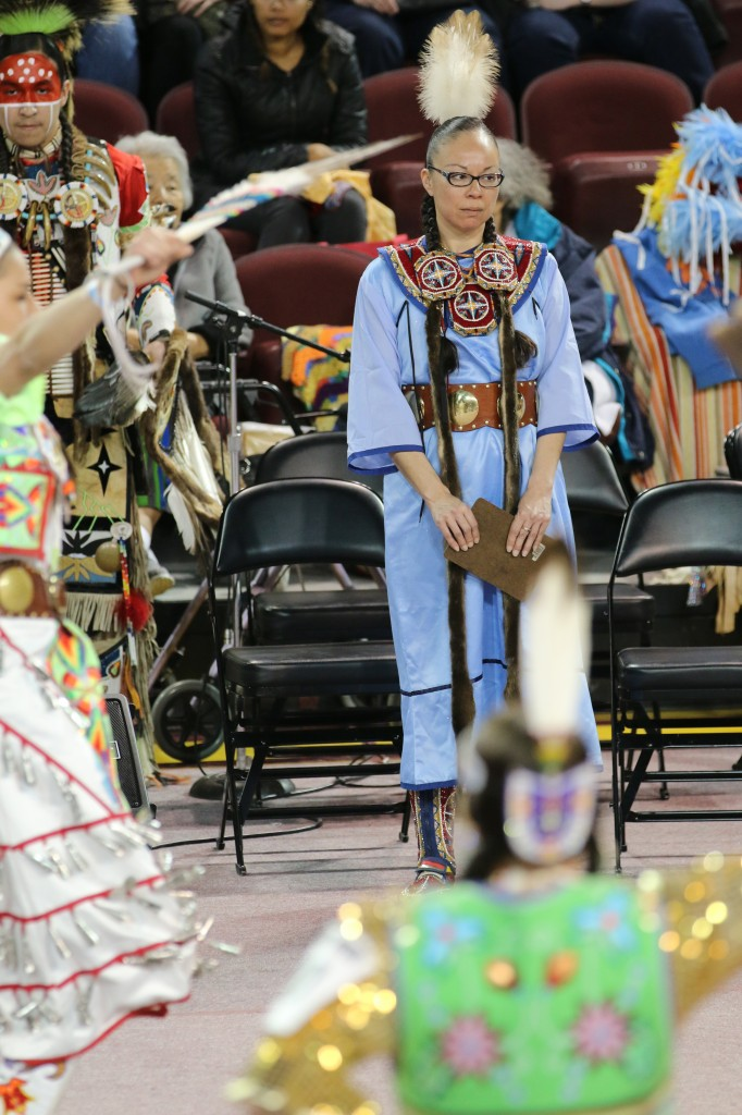 Lisa Hill judges a youth female dance at the 26th Annual Celebrating Life Pow wow. She also competed in the fancy shall dance prior to judging. (Photo I Kaiti Chritz)
