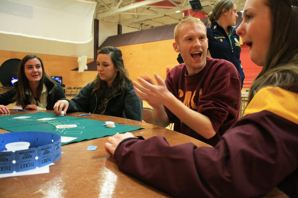 5731, 5734, 5735 Tara DuFresne, Blake Ryan, Jessica Henrickson, Mackenzie Jebb and Amy Hammermeister play a game of Blackjack in the Casino room. (Photo I Erica Benham)