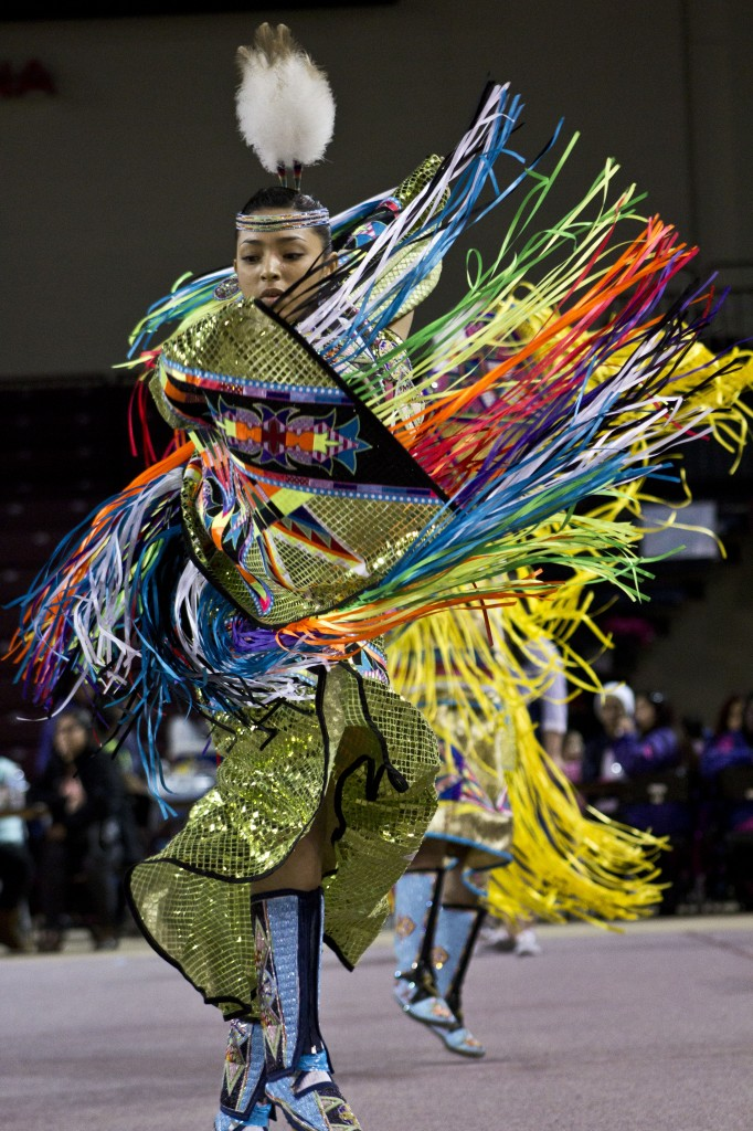 Beedoskah Stonefish, 18, of the Ojibwe tribe dances on Sunday, March 22, 2015 at the Celebrating Life Pow wow. (Photo I Alex Ryske)