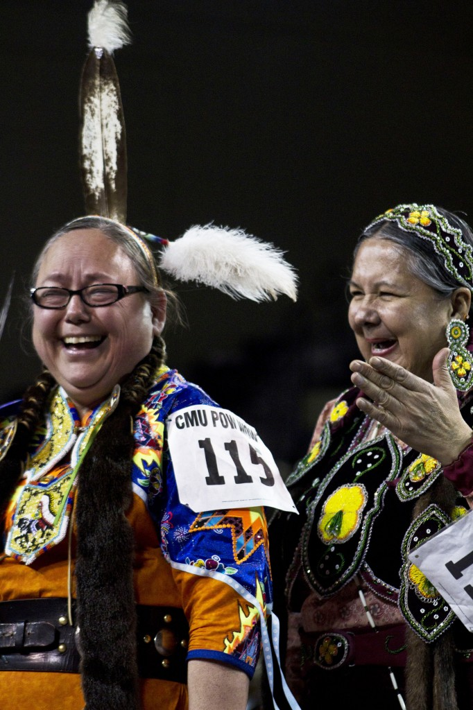 Dancers laugh at the 26th Annual Celebrating Life Pow wow on CMU's campus. (Photo I Alex Ryske)