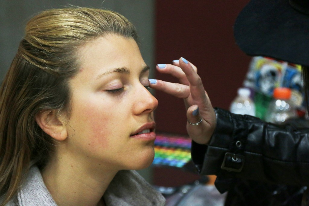 Delaney Dillon, a model at the 2015 Threads Fashion Show, gets her makeup done before the show Saturday, April 25, 2015. (Photo I Kaiti Chritz)