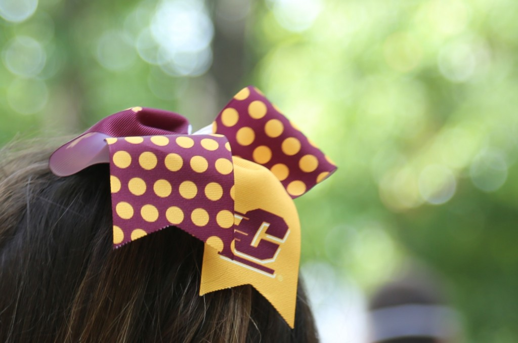 CMU students proudly show off their school spirit around the campus of Mighican State University on Saturday, September 26, 2015, in East Lansing.