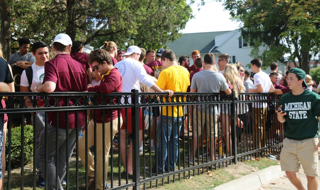 Maroon and Gold takes over as Central Michigan University students tailgate in East Lansing, Michigan, Saturday, September 26, 2015.