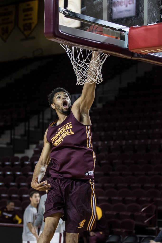 Dahron Scott slams the ball home before the Maroon and Gold Scrimmage in McGuirk Arena, on the campus of Central Michigan University, Mt. Pleasant, MI, Saturday, October 17, 2015.