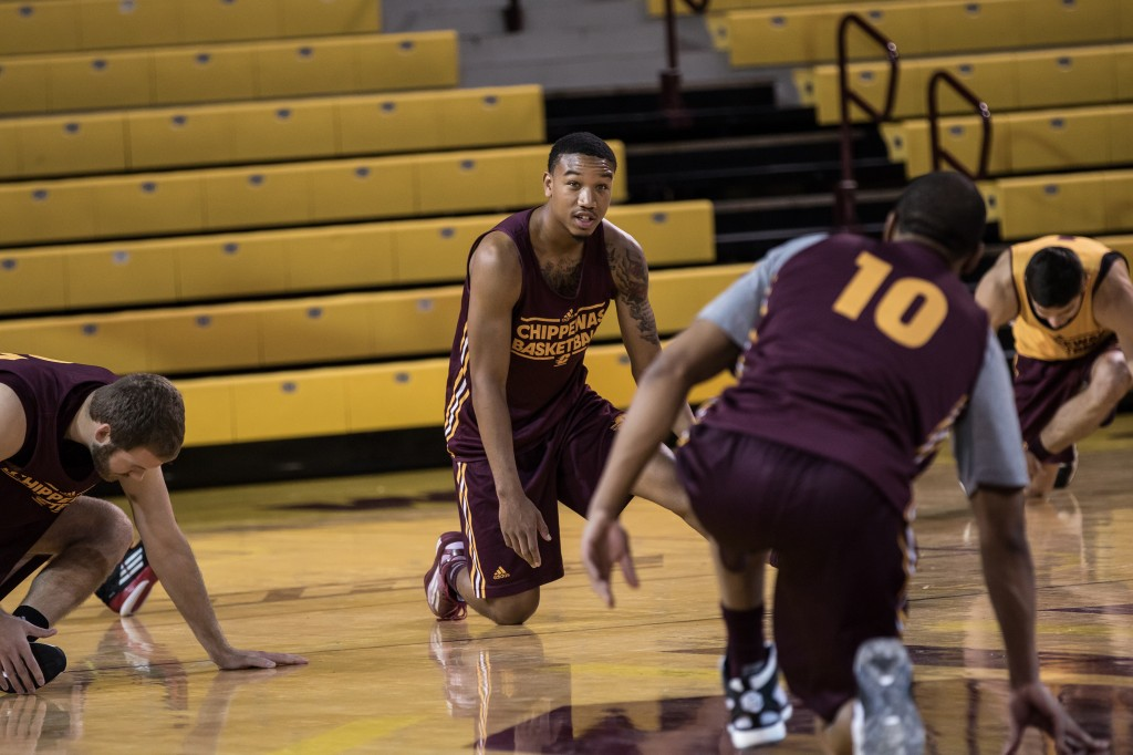 Rayshawn Simmons talks to Austin Stewart while stretching before the Maroon and Gold Scrimmage in McGuirk Arena, on the campus of Central Michigan University, Mt. Pleasant, MI, Saturday, October 17, 2015.