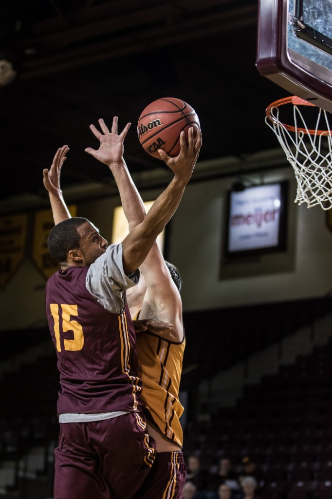 Chris Fowler goes for the one-handed layup during the Maroon and Gold Scrimmage in McGuirk Arena, on the campus of Central Michigan University, Mt. Pleasant, MI, Saturday, October 17, 2015.