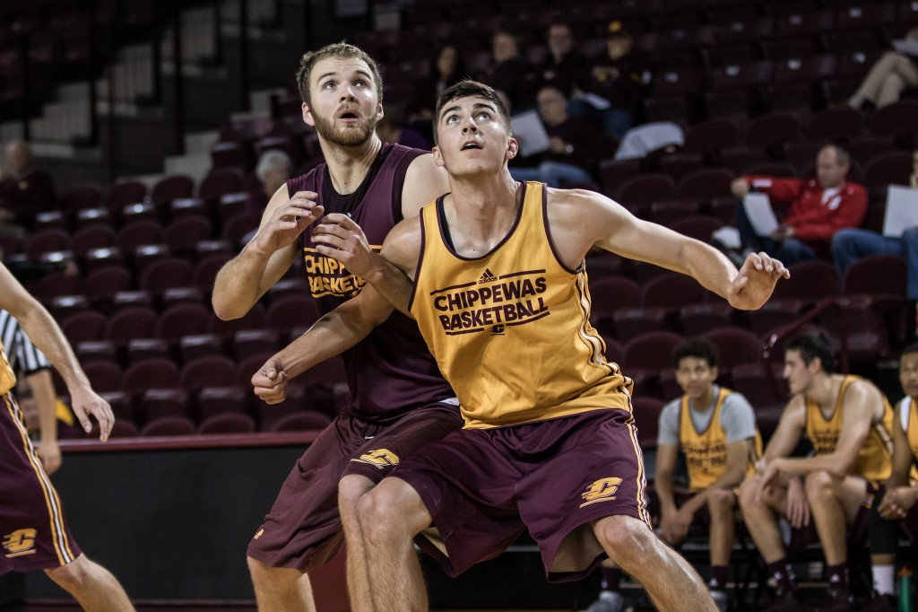 John Simons, left,  battles for the rebound during the Maroon and Gold Scrimmage in McGuirk Arena, on the campus of Central Michigan University, Mt. Pleasant, MI, Saturday, October 17, 2015.