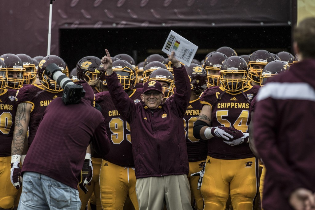 Head Coach John Bonamego leads his team onto the field before the football game against Northern Illinois University on the campus of Central Michigan University, Mt. Pleasant, MI, Sunday, October 3, 2015.