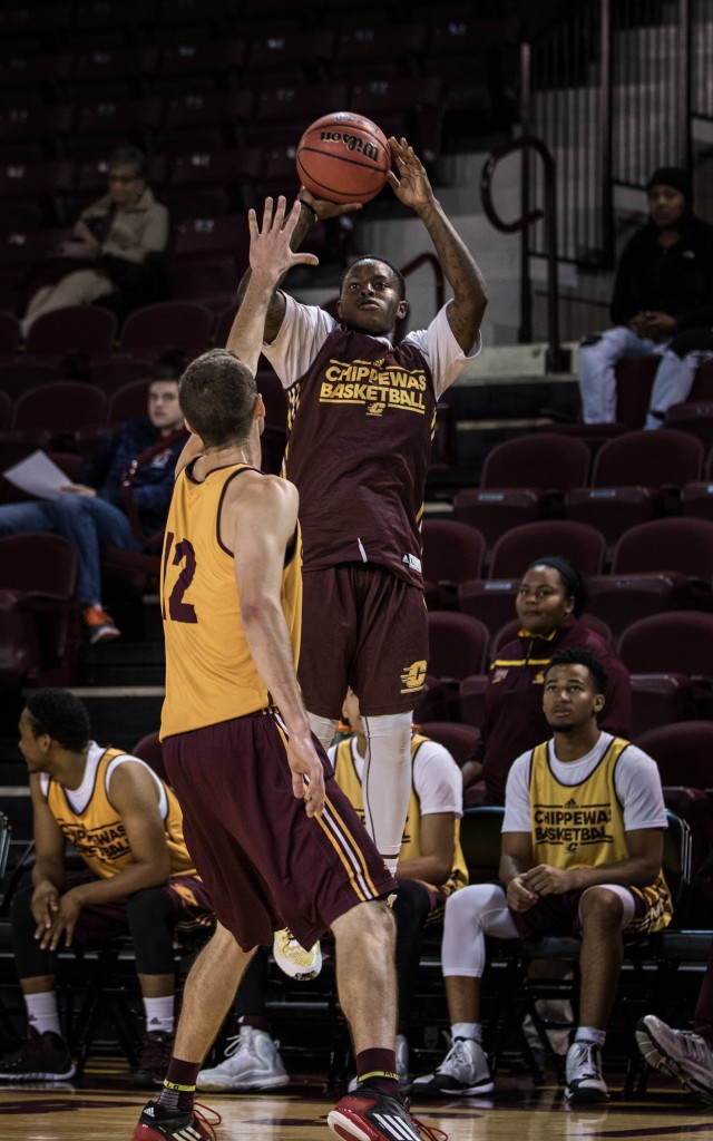 Braylon Rayson, right,  goes up for the jumper against Josh Kozinski, 12, during the Maroon and Gold Scrimmage in McGuirk Arena, on the campus of Central Michigan University, Mt. Pleasant, MI, Saturday, October 17, 2015.