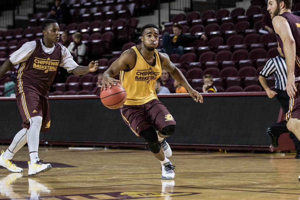 Marcus Keene drives down the floor during the Maroon and Gold Scrimmage in McGuirk Arena, on the campus of Central Michigan University, Mt. Pleasant, MI, Saturday, October 17, 2015.