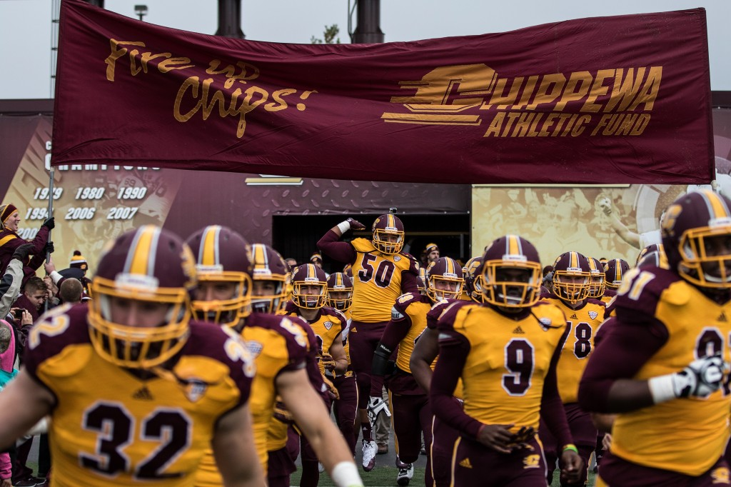 Carlos Clark leaps in the air as the Chippewas take the field before the football game against the University at Buffalo on the campus of Central Michigan University, Mt. Pleasant, MI, Saturday, October 17, 2015.