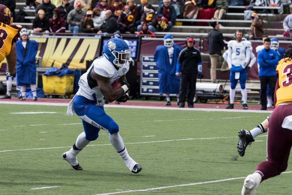 Anthone Taylor, left, darts up the field during the football game against the University at Buffalo on the campus of Central Michigan University, Mt. Pleasant, MI, Saturday, October 17, 2015.