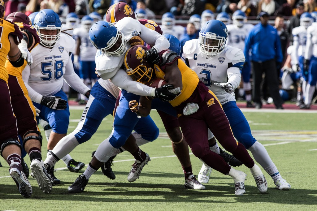 A CMU ball carrier is taken down by a host of Buffalo defenders during the football game against the University at Buffalo on the campus of Central Michigan University, Mt. Pleasant, MI, Saturday, October 17, 2015.