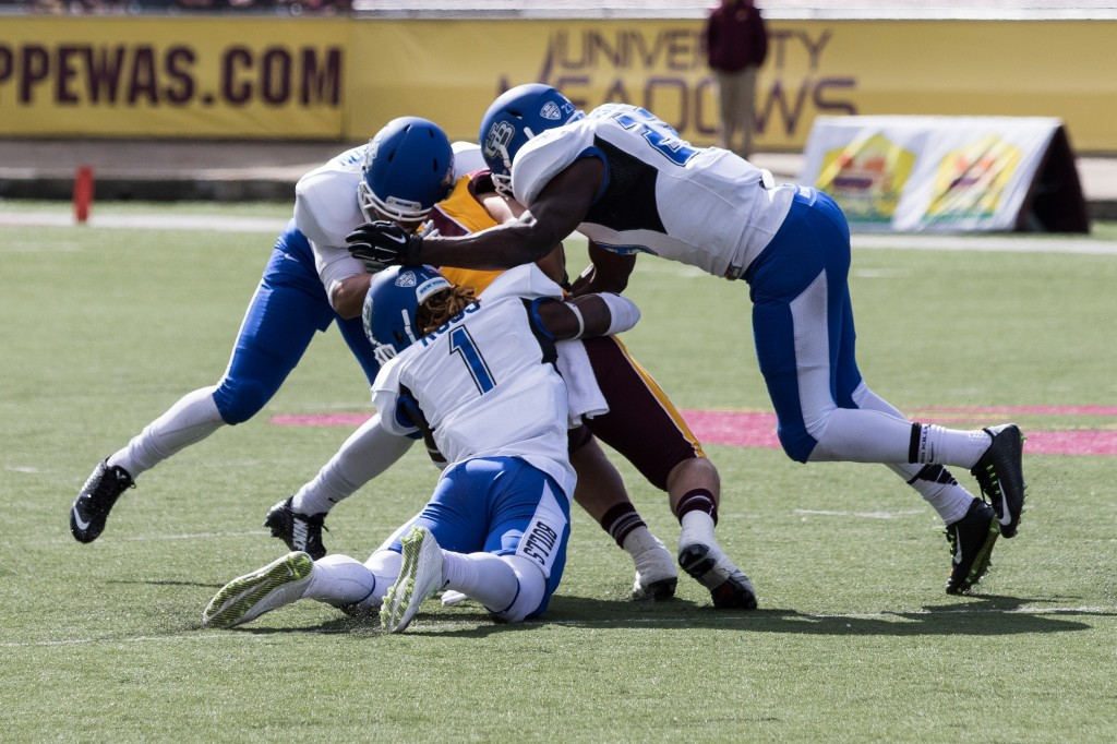 A gnag of Buffalo defenders take down a CMU ball carrier during the football game against the University at Buffalo on the campus of Central Michigan University, Mt. Pleasant, MI, Saturday, October 17, 2015.