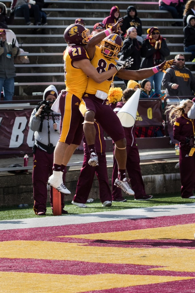 Jessie Kroll, 21, and Ben McCord, 89, celebrate a touchdown during the football game against the University at Buffalo on the campus of Central Michigan University, Mt. Pleasant, MI, Saturday, October 17, 2015.