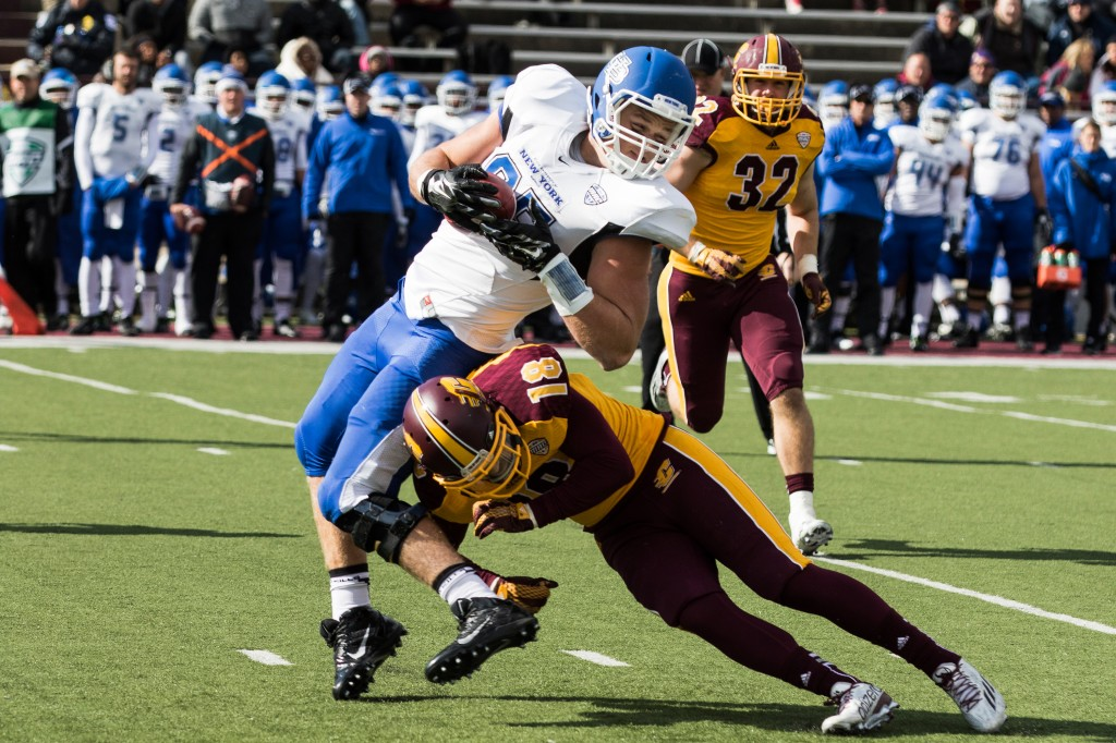Mason Schrek, 85, gets hit at the knee by Tony Annese, 18, during the football game against the University at Buffalo on the campus of Central Michigan University, Mt. Pleasant, MI, Saturday, October 17, 2015.