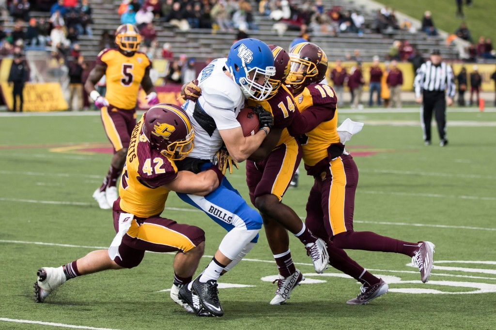 A gang of Chips take down the ball carrier during the football game against the University at Buffalo on the campus of Central Michigan University, Mt. Pleasant, MI, Saturday, October 17, 2015.