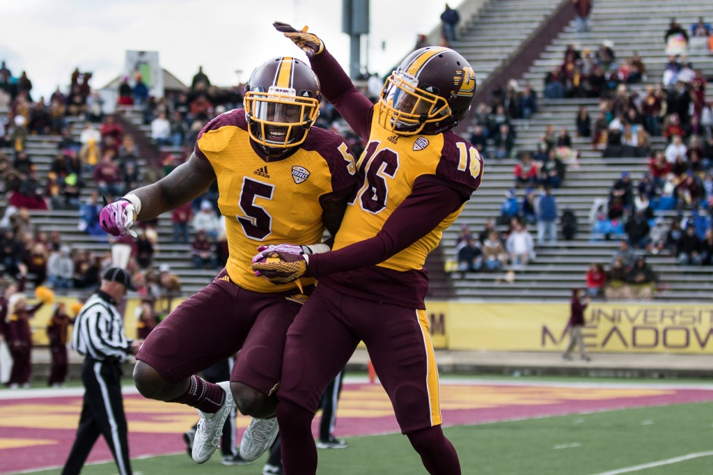 Kavon Frazier, 5, and Stefon Armstead, 16, celebrate a big play during the football game against the University at Buffalo on the campus of Central Michigan University, Mt. Pleasant, MI, Saturday, October 17, 2015.