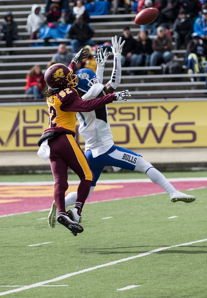 Corey WIllis, 82,  battles for a ball against Boise Ross, right, during the football game against the University at Buffalo on the campus of Central Michigan University, Mt. Pleasant, MI, Saturday, October 17, 2015.