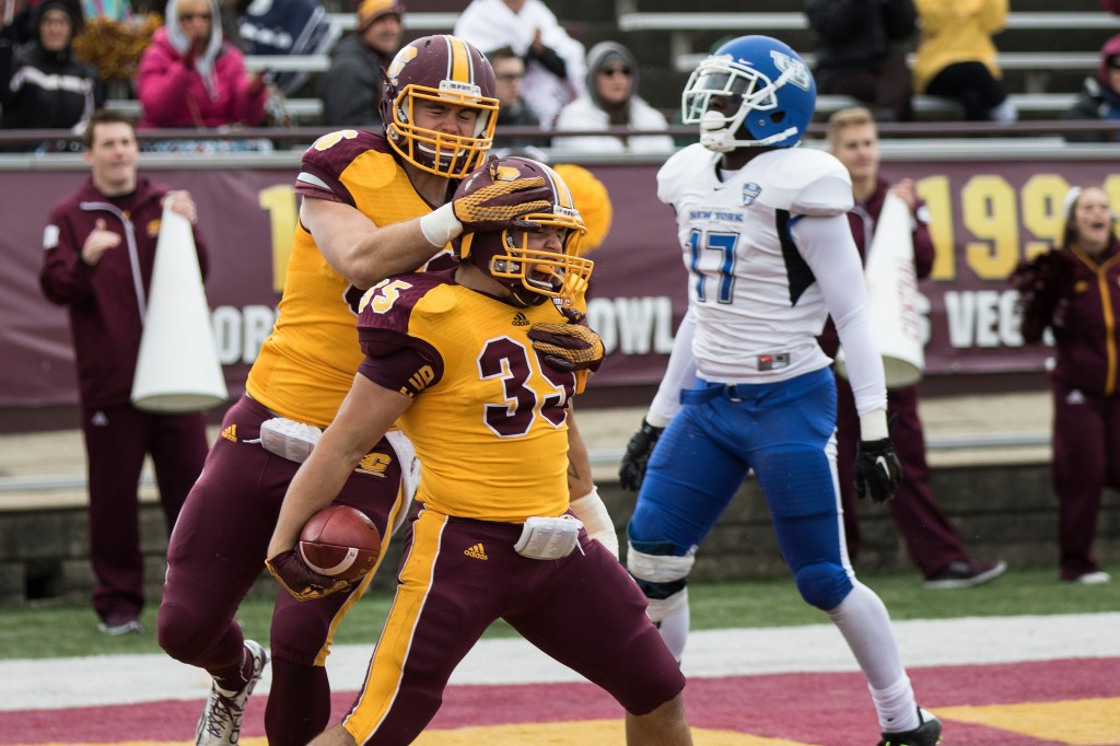 Trevor Thomas, 35, and Zach Crouch, left, celebrate a touchdown during the football game against the University at Buffalo on the campus of Central Michigan University, Mt. Pleasant, MI, Saturday, October 17, 2015.