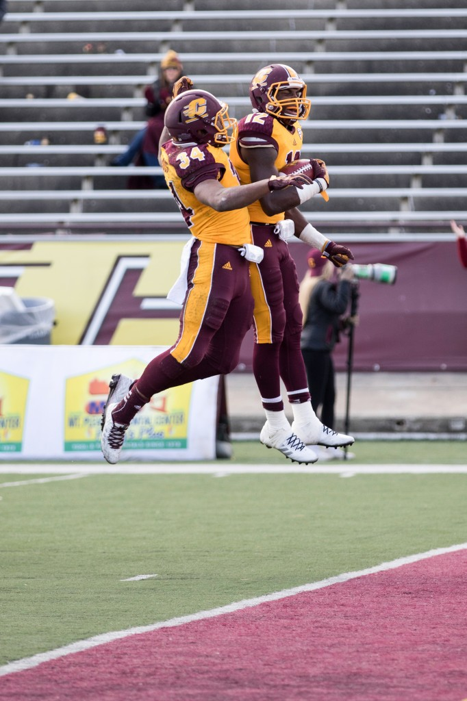 Romello Ross, 34, and Eric Cooper, 12, celebrate a touchdown during the football game against the University at Buffalo on the campus of Central Michigan University, Mt. Pleasant, MI, Saturday, October 17, 2015.
