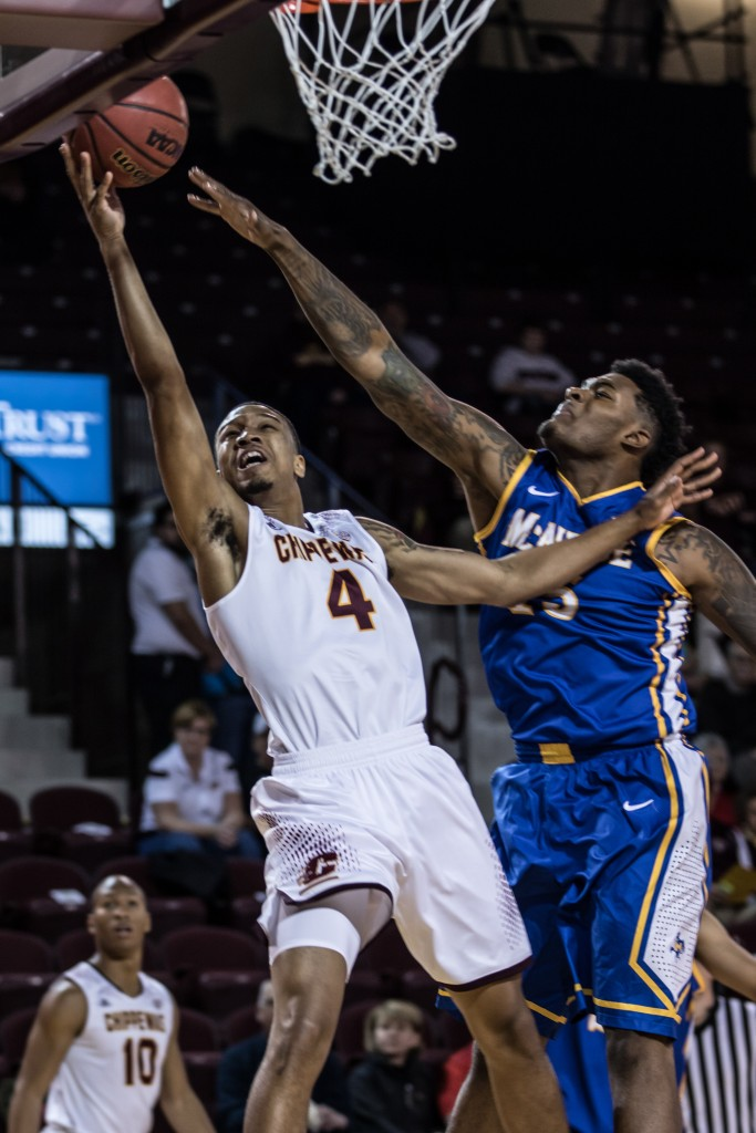 Rayshawn Simmons, 4, attempts a lay up against Craig McFerrin, 15, during the game against McNeese State University in McGuirk Arena on the campus of Central Michigan University, Mt. Pleasant, Michigan, Monday, November 30, 2015.