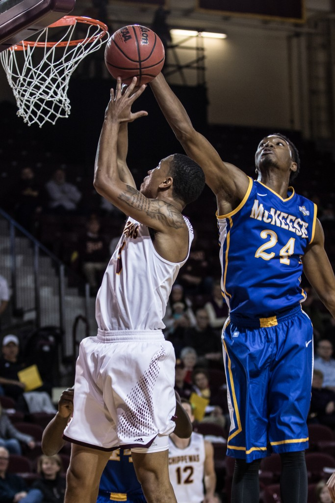 Rayshawn Simmons, 4, is blocked by Lance Potier, 24, during the game against McNeese State University in McGuirk Arena on the campus of Central Michigan University, Mt. Pleasant, Michigan, Monday, November 30, 2015.