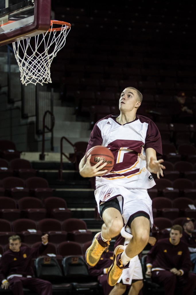 Luke Meyer attempts a craddel dunk before the game against Alma College at McGuirk Arena in Mt. Pleasant, Michigan, Tuesday, November 17, 2015.