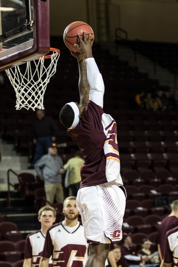Braylon Rayson grabs the two handed alley oop before the game against Alma College at McGuirk Arena in Mt. Pleasant, Michigan, Tuesday, November 17, 2015.