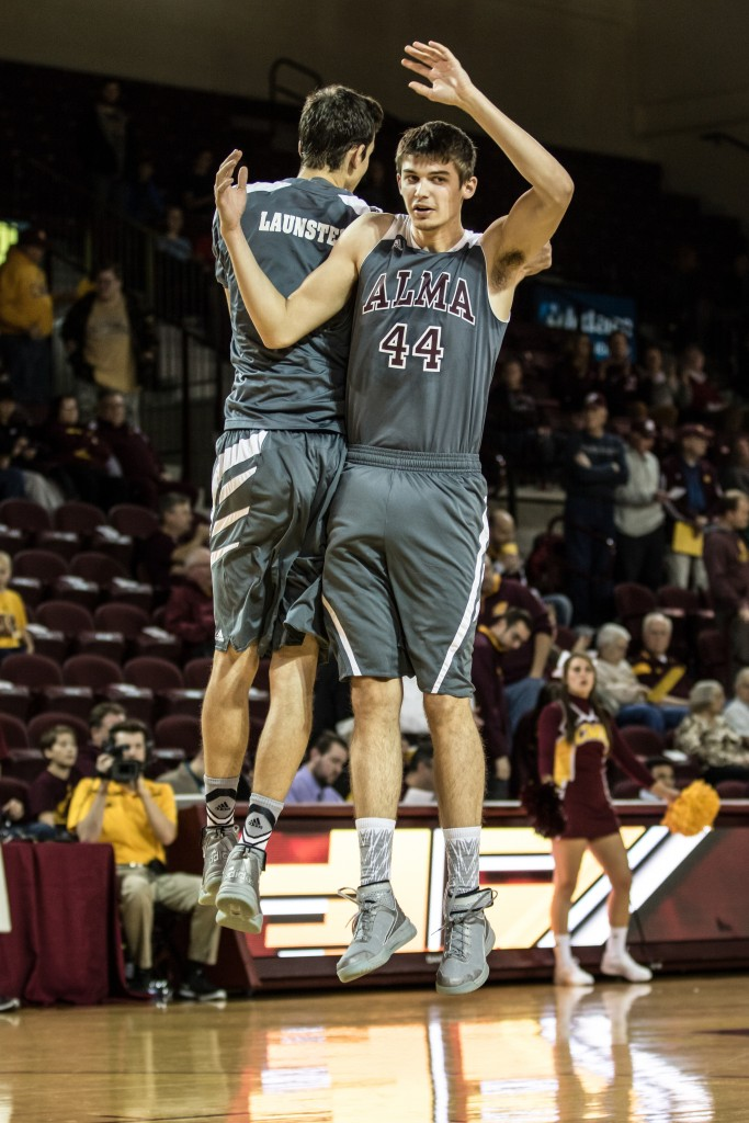Matt Launstein, left, and Doug Bradfield, 44, celebrate before the game, 44, e at McGuirk Arena in Mt. Pleasant, Michigan, Tuesday, November 17, 2015.