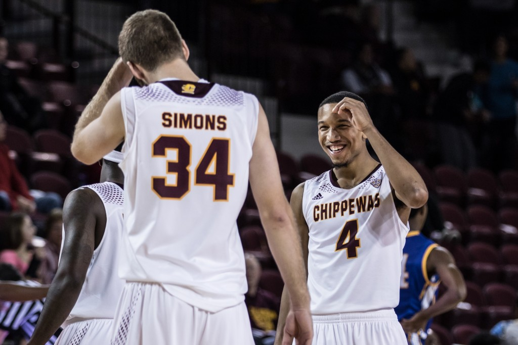 Rayshawn Simmons, 4, laughs with John Simons, 34, during the game against McNeese State University in McGuirk Arena on the campus of Central Michigan University, Mt. Pleasant, Michigan, Monday, November 30, 2015.