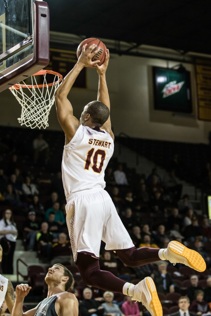 Austin Stewart, 10, skies for the two handed dunk during the game against Alma College at McGuirk Arena in Mt. Pleasant, Michigan, Tuesday, November 17, 2015.
