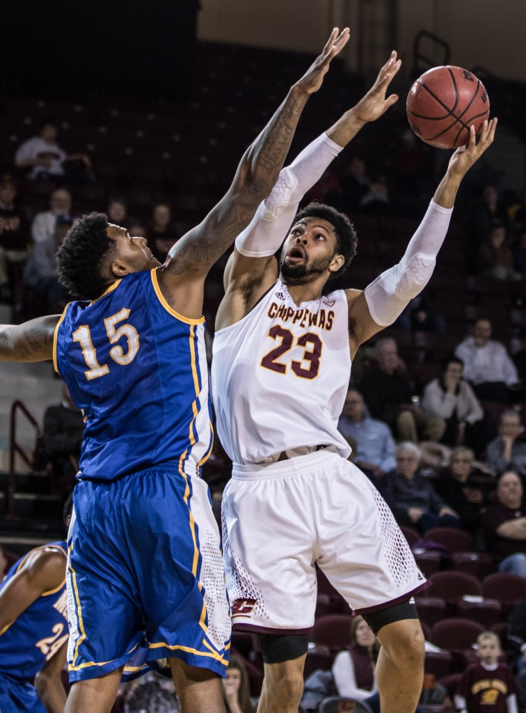 DaRohn Scott, 23, goes up against Craig McFerrin, 15, during the game against McNeese State University in McGuirk Arena on the campus of Central Michigan University, Mt. Pleasant, Michigan, Monday, November 30, 2015.