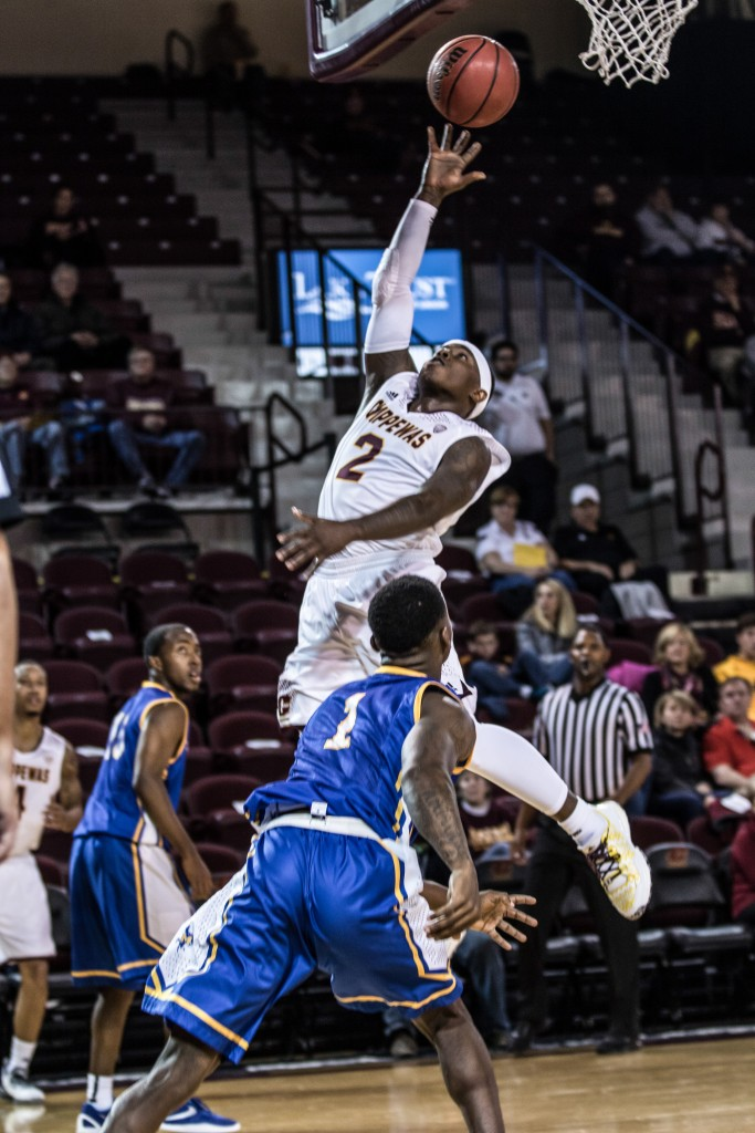 Braylon Rayson, 2, throws up the lay up during the game against McNeese State University in McGuirk Arena on the campus of Central Michigan University, Mt. Pleasant, Michigan, Monday, November 30, 2015.