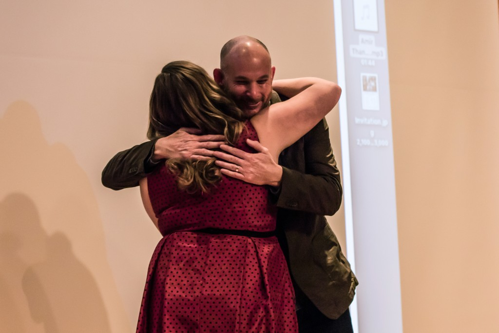 Rachel Harrison, left, hugs Danny Wilcox Frazier, right, after her presentation during the Fences presentation in the Park Library Auditorium on the campus of Central Michigan University, Mt. Pleasant, Michigan, Saturday, November 14, 2015.