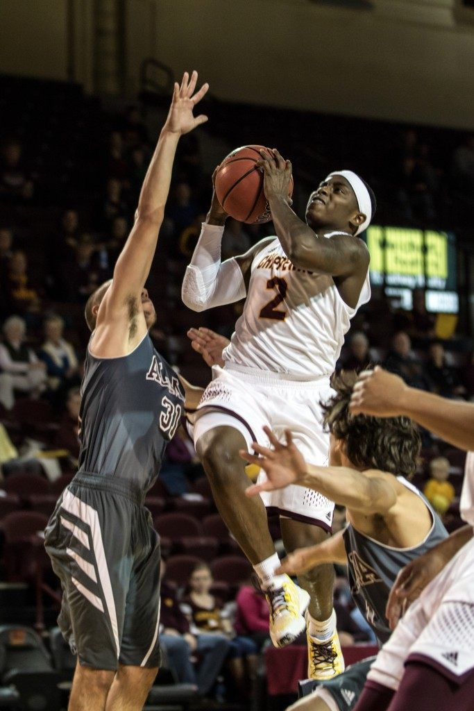 Braylon Rayson, 2, attempts a lay up against Chase Fairchild, 31, during the game against Alma College at McGuirk Arena in Mt. Pleasant, Michigan, Tuesday, November 17, 2015.