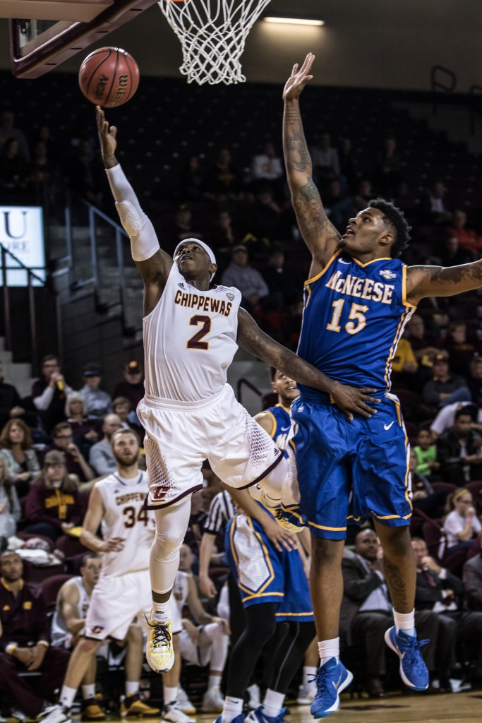 Braylon Rayson, 2, goes for the lay up against Craig McFerrin, 15, during the game against McNeese State University in McGuirk Arena on the campus of Central Michigan University, Mt. Pleasant, Michigan, Monday, November 30, 2015.