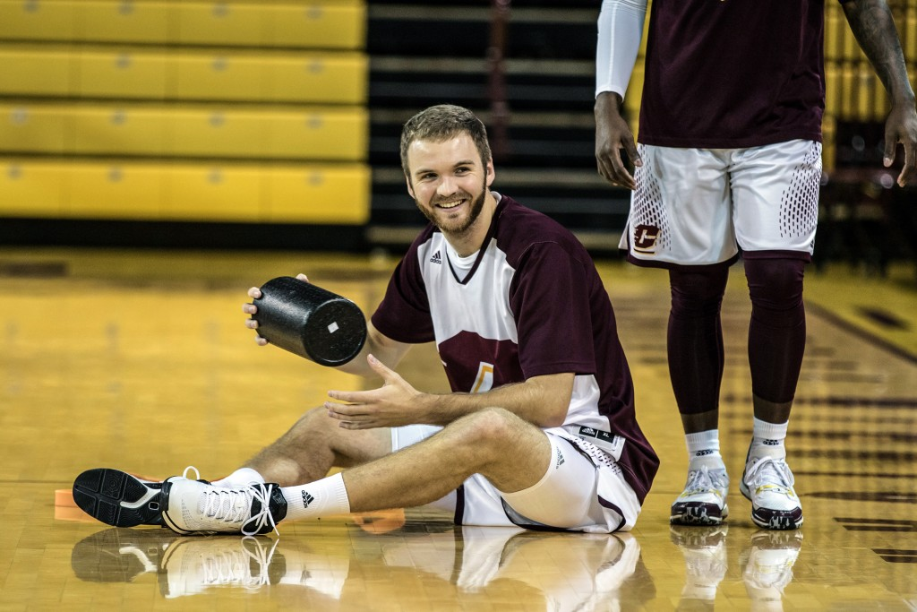 John Simons laughs while stretching before the game against Ferris State University in McGuirk Arena on the campus of Central Michigan University, Mt. Pleasant, Michigan, Saturday, November 7, 2015.