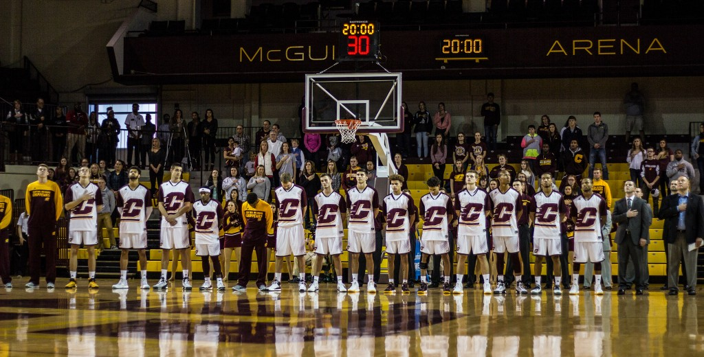 The Central Michigan University basketball team stands for the National Anthem before the game against Ferris State University in McGuirk Arena on the campus of Central Michigan University, Mt. Pleasant, Michigan, Saturday, November 7, 2015.