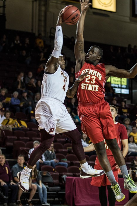 Braylon Rayson, 2, looks for a pass agaisnt Matt Sinnaeve, 23, during the game against Ferris State University in McGuirk Arena on the campus of Central Michigan University, Mt. Pleasant, Michigan, Saturday, November 7, 2015.