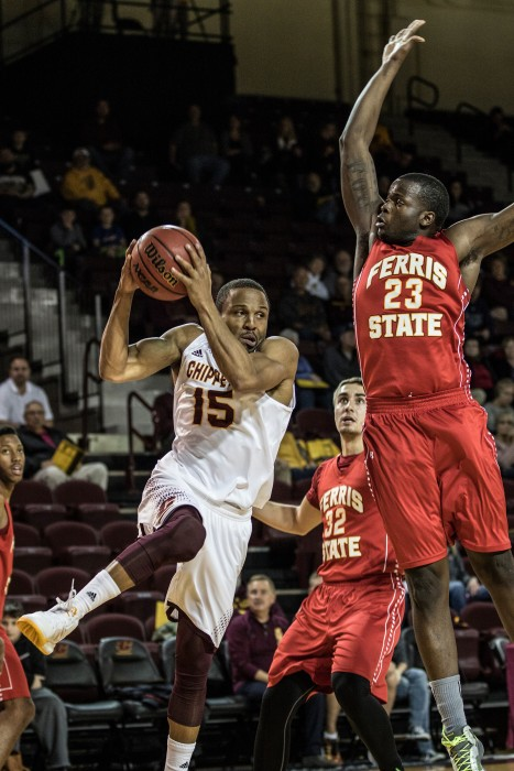 Chris Fowler, 15, goes up against Matt Sinnaeve, 23, during the game against Ferris State University in McGuirk Arena on the campus of Central Michigan University, Mt. Pleasant, Michigan, Saturday, November 7, 2015.