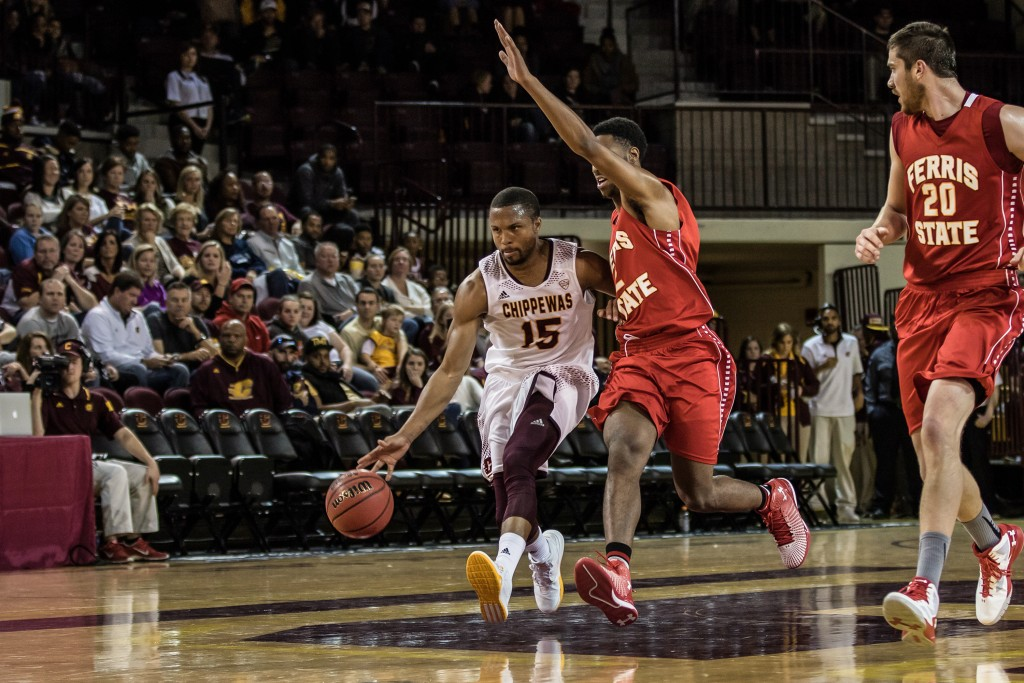 Chris Fowler, 15, drives the ball down the court during the game against Ferris State University in McGuirk Arena on the campus of Central Michigan University, Mt. Pleasant, Michigan, Saturday, November 7, 2015.